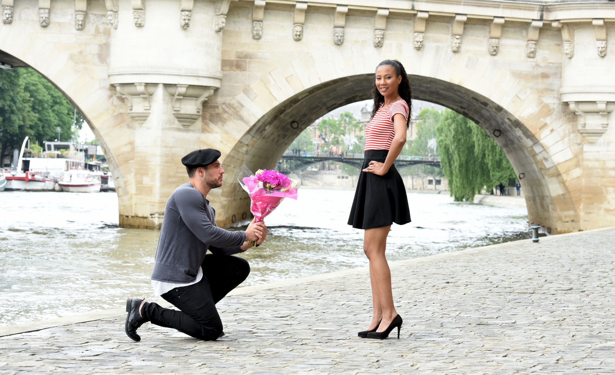 Man presenting rose to his girl